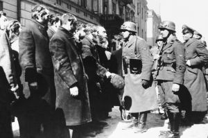 Nazi officers talk with citizens of the Warsaw ghetto, Poland, spring 1943.  (AP Photo)